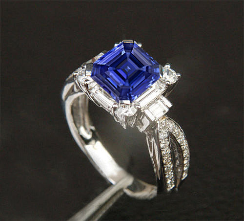 Sapphire  -  2ct, 6.5mm Asscher Cut Kashmir Blue Cultured Sapphire set in a 14k White Gold Baguette and Round Diamond Setting