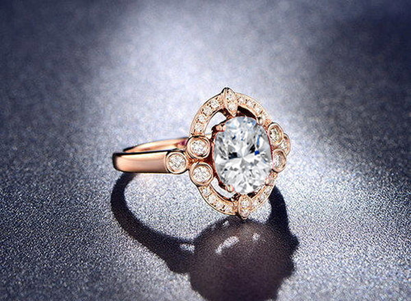 Moissanite Engagement Ring 2.25ct, 7x9mm Oval Forever Brilliant Moissanite Bezel set in a 14K Rose Gold Art Deco Diamond Halo Setting - In The IceBox