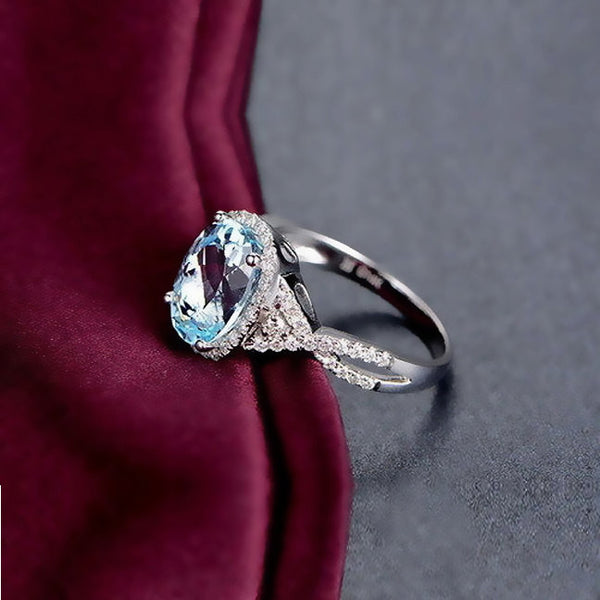 Aquamarine Engagement Ring - 4ct, 8 x 10mm Oval Aquamarine set in a 14k White Gold Twist Shank Diamond Halo