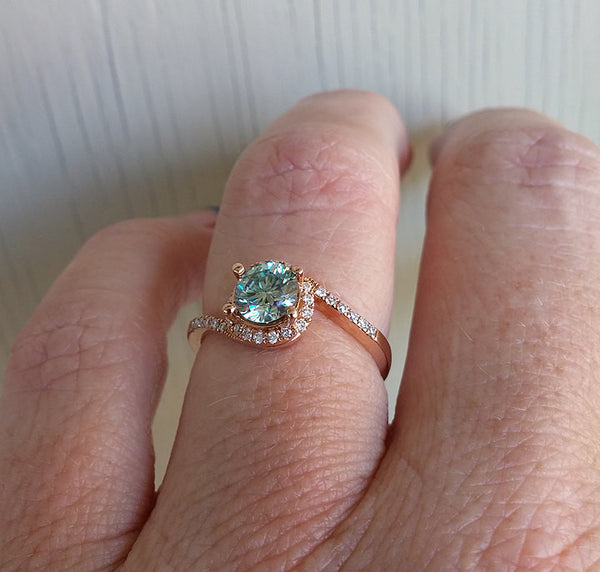 Rare Sky Blue Moissanite Engagement Ring -  6mm .80ct Round Sky Blue Moissanite in a 14K Rose Gold Diamond Bypass Halo Setting