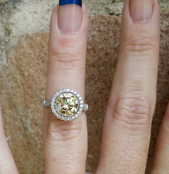 Round Cut Canary Moissanite in a 14K White Gold Diamond Halo Setting with Hidden Birthstones