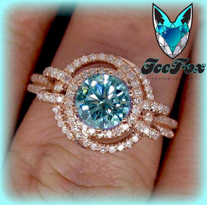 Moissanite - Engagement Ring -  6.5mm, 1.2ct Round Blue Moissanite set in a 14K Rose Gold Knot Setting - In The IceBox