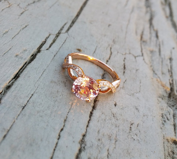 Breast Cancer ring Survivor or Memorial 8mm Round Cultured Pink Sapphire set in a 14K Rose Gold Ribbon Twist Band