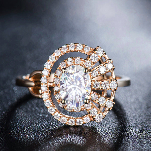 Oval Moissanite Engagement Ring - 7x5mm, 1ct Oval Moissanite Set in a 14K Rose Gold Asymmetrical Diamond Halo Setting - In The IceBox