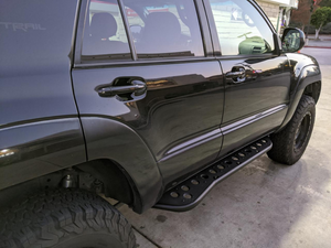 Rear passenger side view of Toyota 4Runner with Step Edition bolt on rock sliders - Cali Raised LED