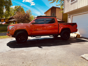 Side view of Economy Roof Rack with amber light baron a red Toyota Tacoma - Cali Raised LED