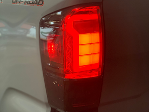 Close up of Toyota Tacoma Raptor Style Tail Lights (brake light on) - Cali Raised LED