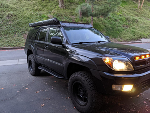 Front passenger side view of Toyota 4Runner with Step Edition bolt on rock sliders - Cali Raised LED