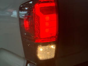 Close up of Toyota Tacoma Raptor Style Tail Lights (brake/reverse light on) - Cali Raised LED