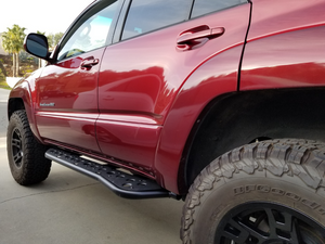 Rear drivers side view of Toyota 4Runner with Step Edition bolt on rock sliders - Cali Raised LED