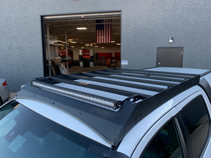 Top view of Economy Roof Rack on a white Toyota Tacoma - Cali Raised LED
