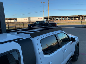 Rear view of Economy Roof Rack on a white Toyota Tacoma - Cali Raised LED