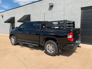 Rear drivers side view of black Toyota Tundra with Overland Bed Rack - Cali Raised LED
