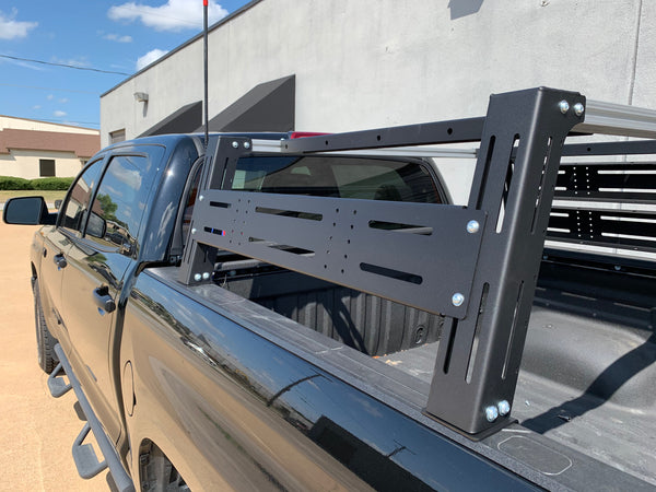 Close-up rear drivers side view of black Toyota Tundra with Overland Bed Rack - Cali Raised LED