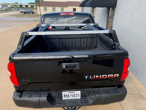Rear view of black Toyota Tundra with Overland Bed Rack - Cali Raised LED