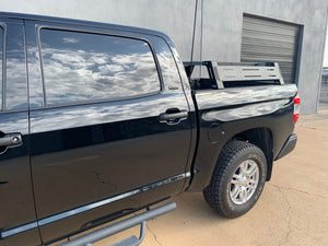 Drivers side angled view of black Toyota Tundra with Overland Bed Rack - Cali Raised LED