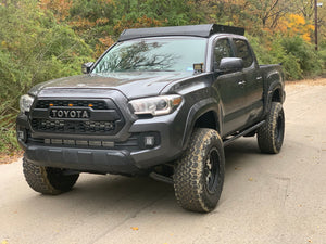Front drivers side view of gray Toyota Tacoma with Premium roof rack - Cali Raised LED
