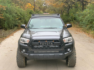 Front view of gray Toyota Tacoma with Premium roof rack with covered light bar - Cali Raised LED