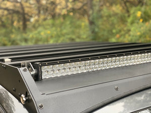 Close up view of gray Toyota Tacoma with Premium Roof Rack with exposed light bar- Cali Raised LED