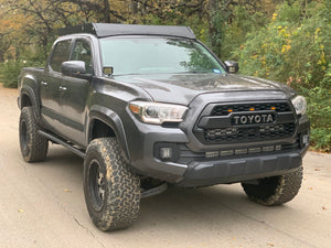 Front passengers side view of gray Toyota Tacoma with Premium roof rack - Cali Raised LED