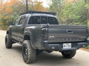 Rear view of gray Toyota Tacoma with Premium roof rack - Cali Raised LED