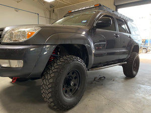 Front drivers side view of gray 4Runner with Trail Edition bolt on rock sliders - Cali Raised LED