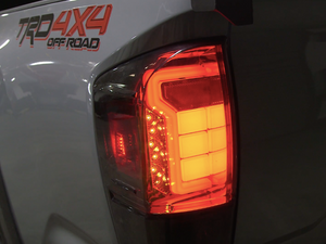 Close up of Toyota Tacoma Raptor Style Tail Lights (brake light/turn signal on) - Cali Raised LED