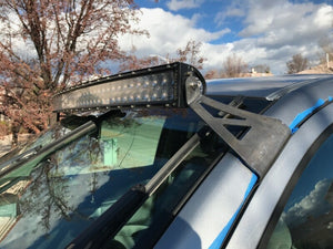 Curved LED light bar and roof mounting brackets on gray Toyota Tundra - Cali Raised LED