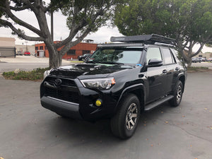 Black Toyota 4Runner from a distance with LED light bar and roof mounting brackets - Cali Raised LED