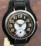 WWl Trench watch with black enamel on white porcelain dial, Valjoux 7736, and Silver Case - HallandLaddco.com