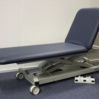 All Electric Medical Couch with electric lock wheels, electric back rest and height adjustment.