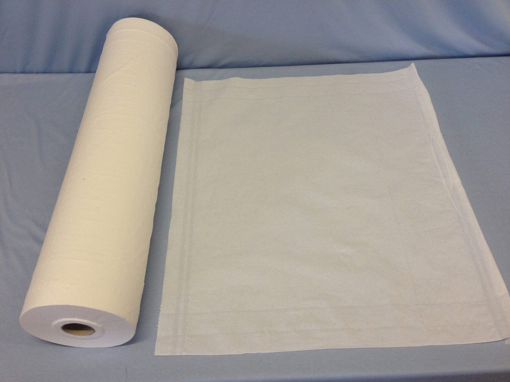 Soft to touch fenestrated disposable paper beds sheet rolls 59cm x 100cm sheets on 100m roll
