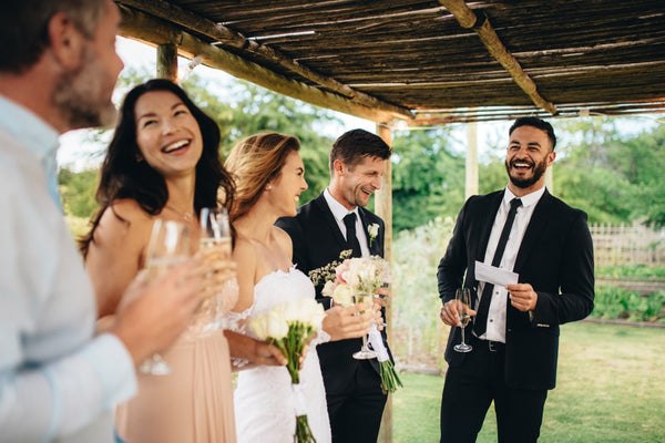 best man giving speech to newly wedded couple at wedding reception - best man tips