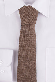 Close up of Classic Brown Barleycorn Tweed Tie on a single cuff shirt