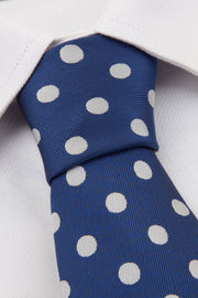 Close up of Navy Polkadot Tie on a white shirt