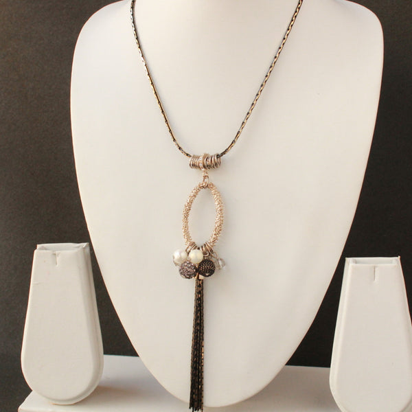 Designer chain necklace with mesh chain oval shape brown chain pearl designer balls dangling.