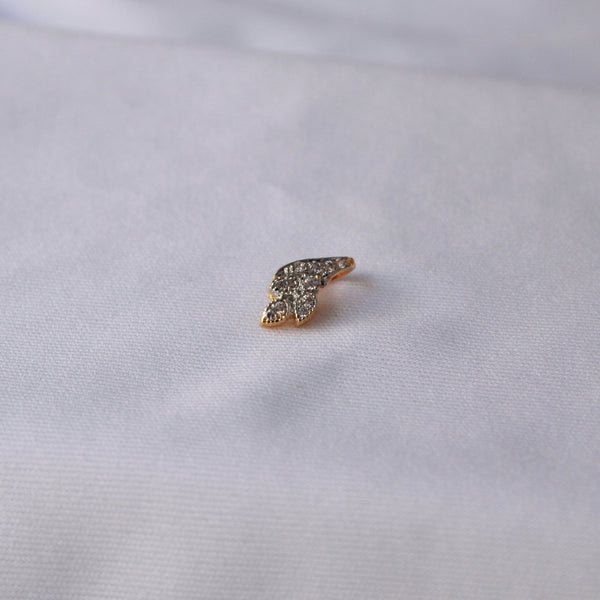 Nose pin with american diamond studded stones.