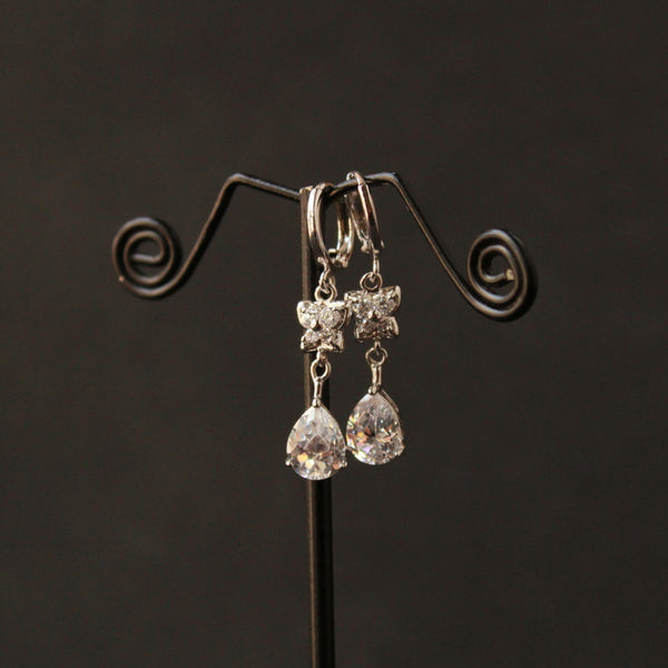Tear Drop Hanging Earring in white polish with american diamond studed