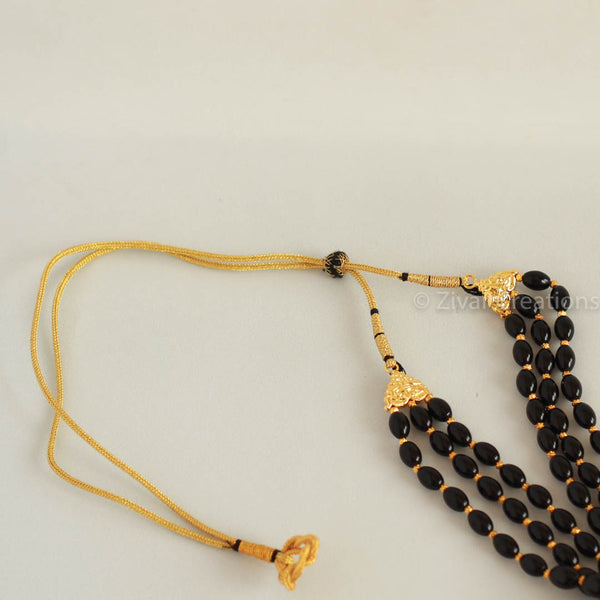 Black beads and pearl necklace