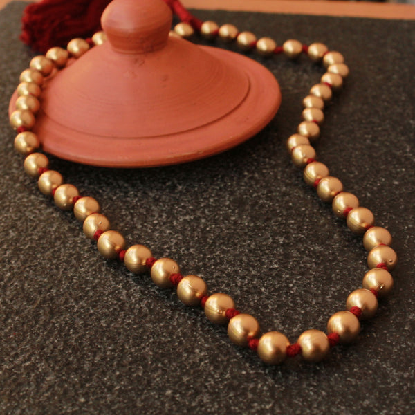 Matte finished beads necklace in maroon thread with adjustable thread.