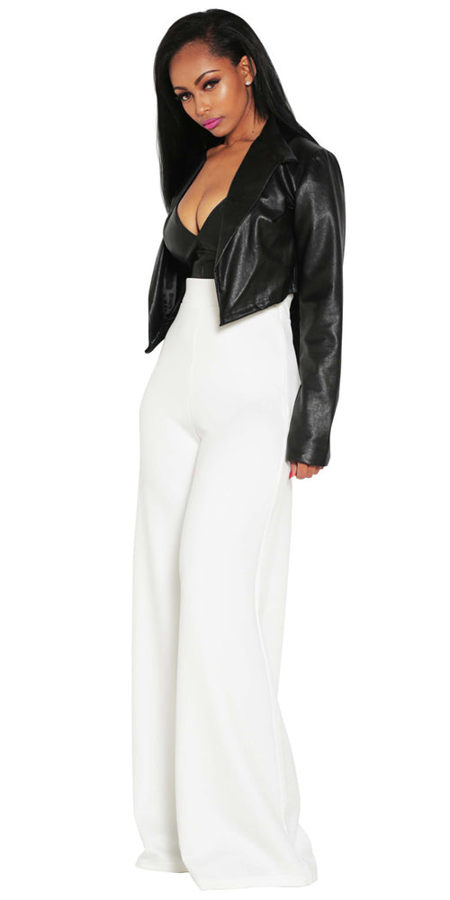 White wide leg high waisted trousers by IMME COLLECTION.