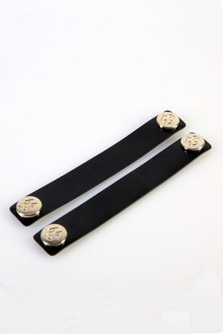 "The Moods Ribbon ""Jealous look"" - Patent black leather for an ultimate glam."