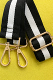 The EW bag strap - black&white - Fine gold color to complete you for the day.
