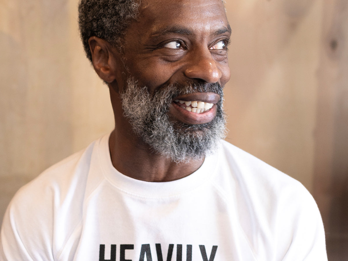 """An image of a black man wearing a shirt from RighteouSouls that says """"Heavily Meditated"""""""