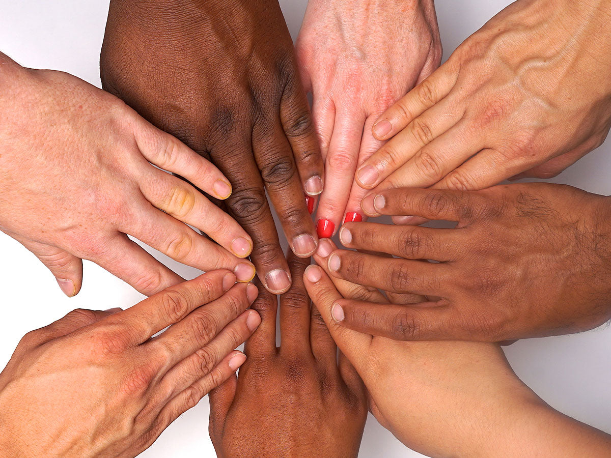 Hands in a circle indicated collaboration, teamwork, and working together.