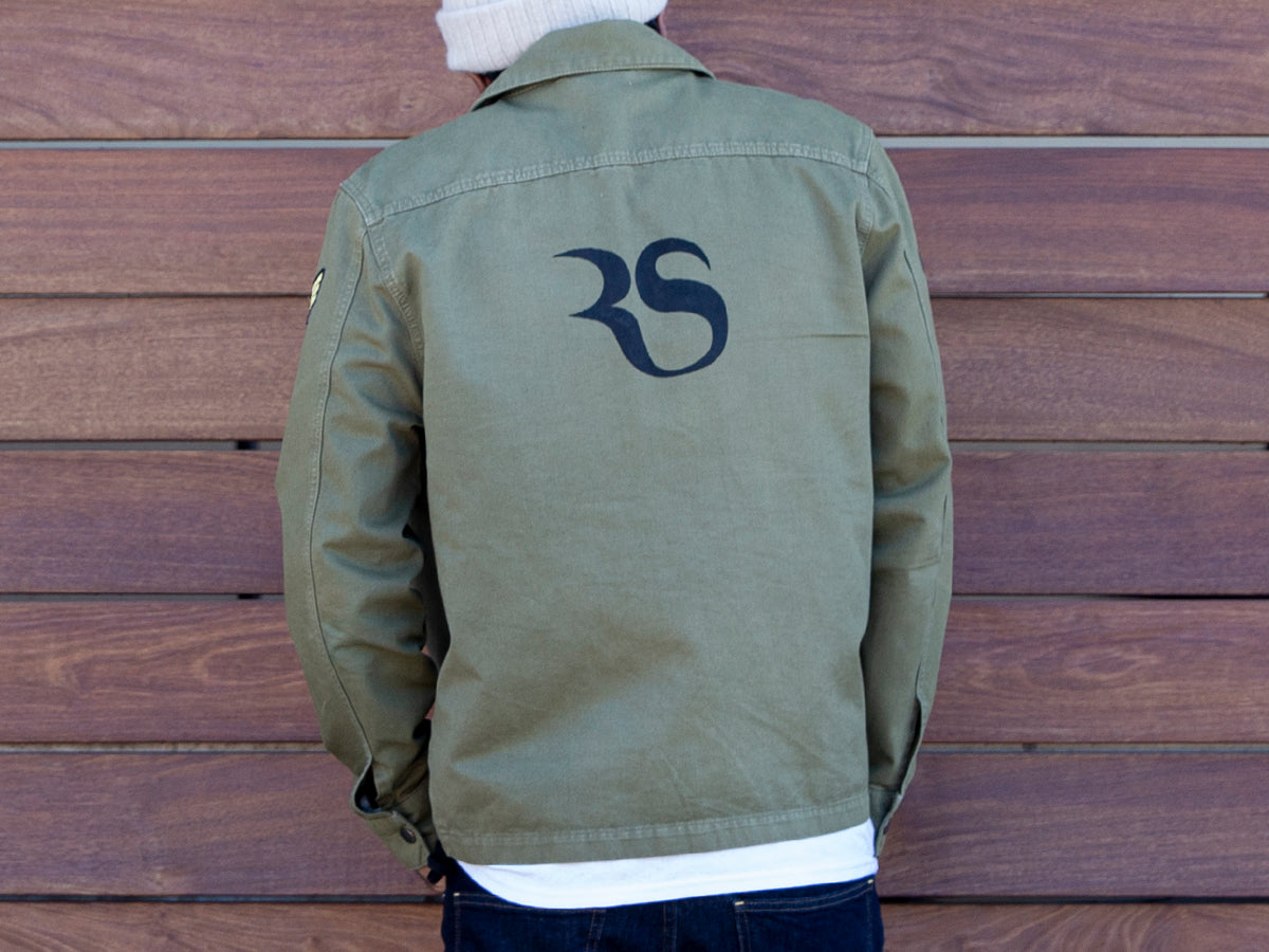 An image of Robert Davis in a RighteouSouls logo army jacket