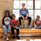 four people sitting on a bench wearing RighteouSouls apparel