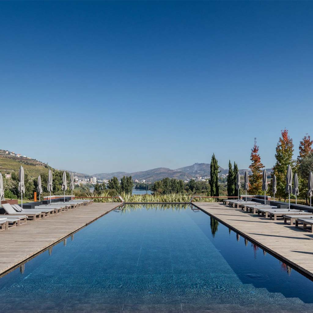 Pool view with Six Senses Duoro Valley in Portugal background
