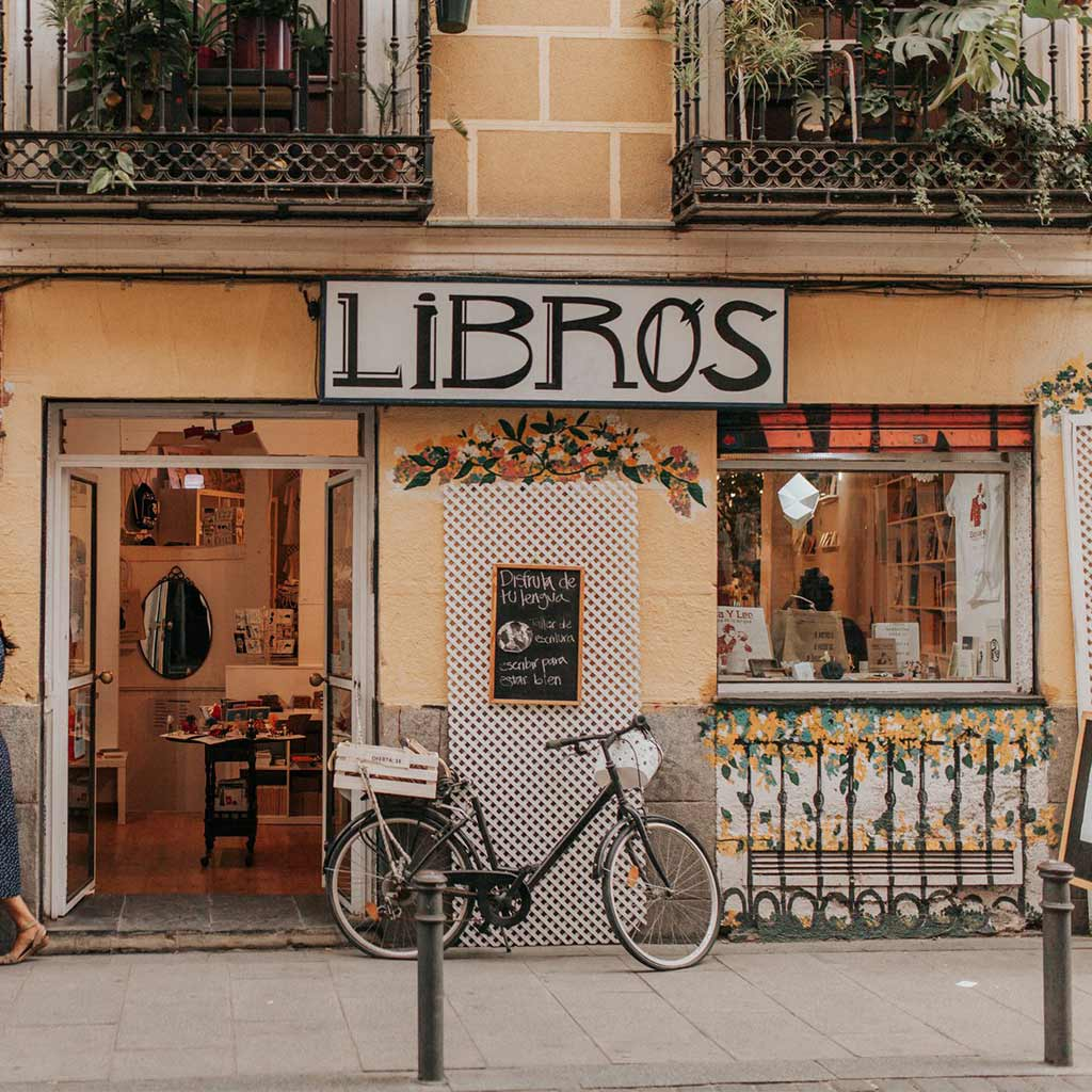 A cafe in Madrid called Libros with bicycle parked outside.