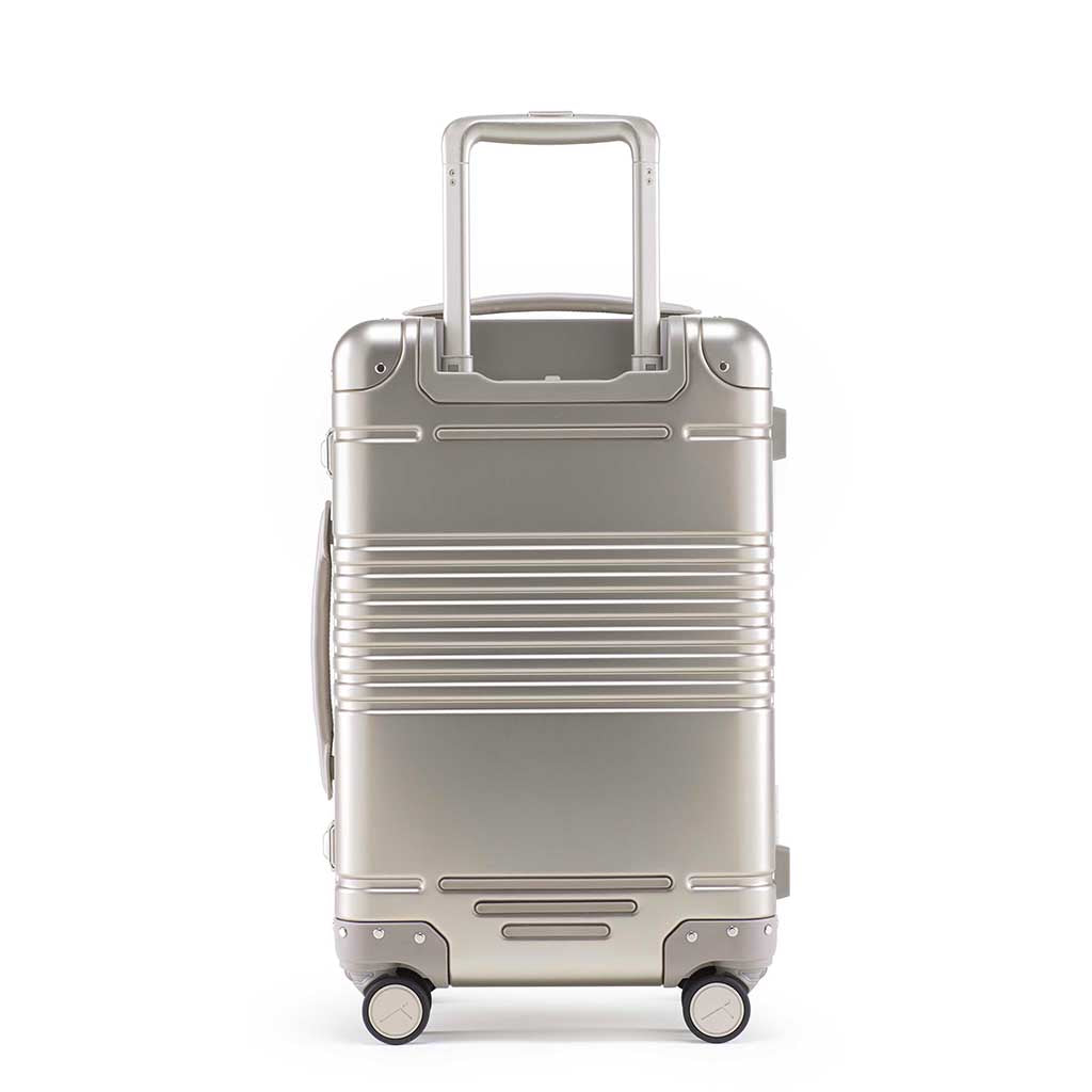 Back view of the frame carry-on in champagne aluminum edition